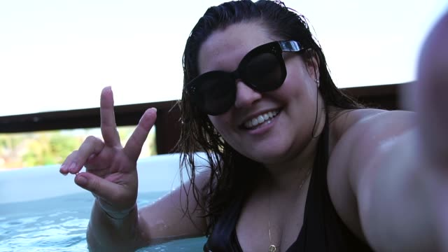 Plus Size Woman Taking a Selfie at Jacuzzi