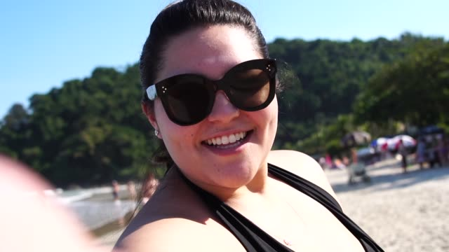 plus size woman taking a selfie at the beach - plus size model stock videos & royalty-free footage