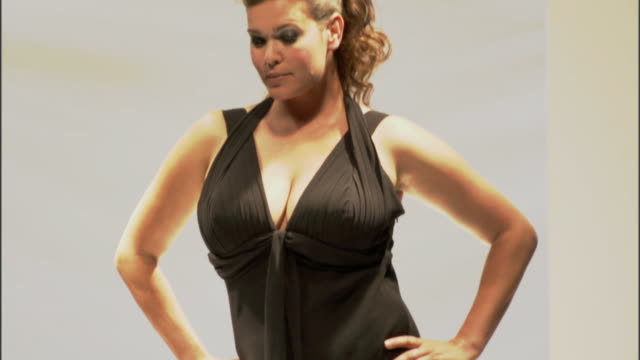 MS TD Plus-size woman modeling black dress and high heels on catwalk / London, England, UK