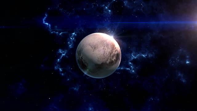 pluto reveal in space - 天文学点の映像素材/bロール