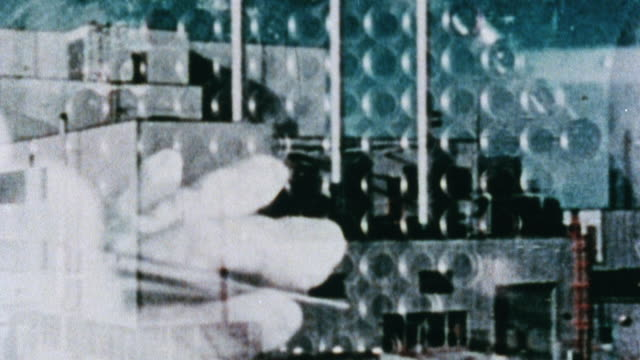 stockvideo's en b-roll-footage met 1981 montage plutonium rods being inserted into breeder reactor and exterior of facility / dounreay, scotland, united kingdom - plutonium