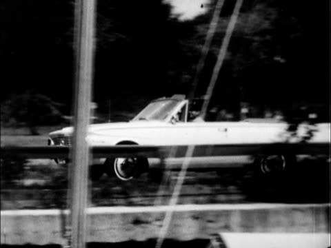 plymouth valiant signet 200 convertible parked at marina man wearing captain's hat gets into car / ws ha looking down on man and woman seated beside... - convertible top stock videos & royalty-free footage