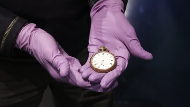 vidéos et rushes de pocket watch belonging to cornishman john chapman, who drowned along with his wife sarah, and is being displayed as part of the new titanic stories... - titanic