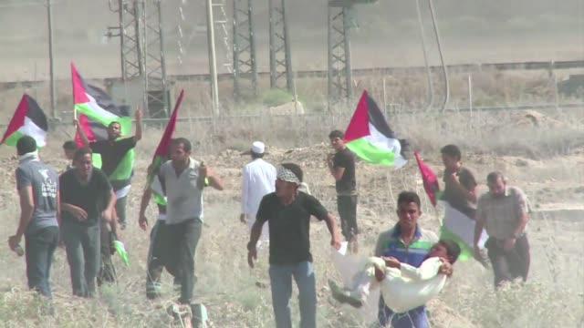 a poco de cumplirse 13 anos del comienzo de la segunda intifada palestina contra la ocupacion israeli miles de personas marcharon en gaza y... - palestina stock videos and b-roll footage