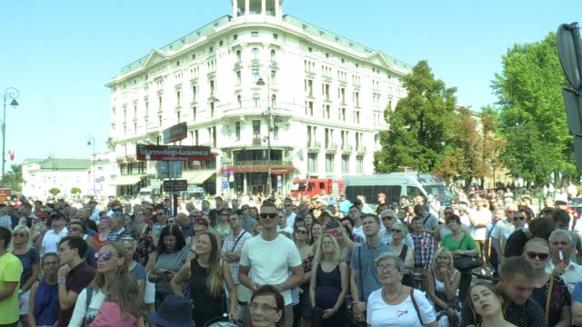 poeple are seen watching a large screen showing the official ceremony of the 80th annivesary of the start of wwii in warsaw, poland on september 1,... - large scale screen stock videos & royalty-free footage