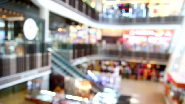 poeple in shopping mall blur background with bokeh - market retail space stock videos & royalty-free footage