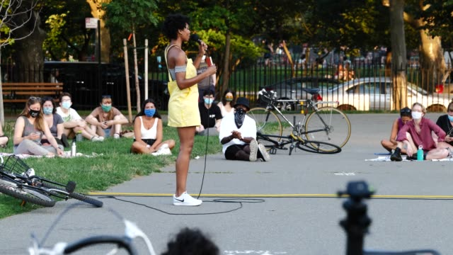 poet mel chante reads during the womxn poets for black lives event on the 54th night of the george floyd vigil at mccarren park. - literatur stock-videos und b-roll-filmmaterial