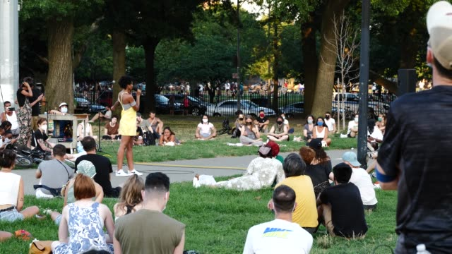 poet mel chante reads during the womxn poets for black lives event on the 54th night of the george floyd vigil at mccarren park. - poet stock videos & royalty-free footage
