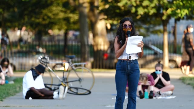 poet melissa hunter gurney reads to crowd during the womxn poets for black lives event on the 54th night of the george floyd vigil at mccarren park. - poet stock videos & royalty-free footage