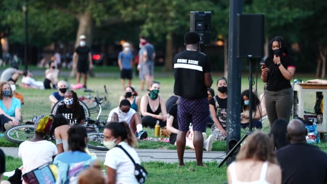 poet nircia carmona reads during the womxn poets for black lives event on the 54th night of the george floyd vigil at mccarren park. - poet stock videos & royalty-free footage