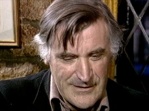 poet ted hughes comments on being announced as poet laureate 1984 - literatur stock-videos und b-roll-filmmaterial