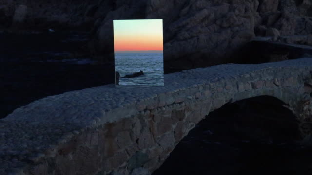 poetical footage of the sunrise seen through a mirror in the mediterranean sea coastline. - rectangle stock videos & royalty-free footage