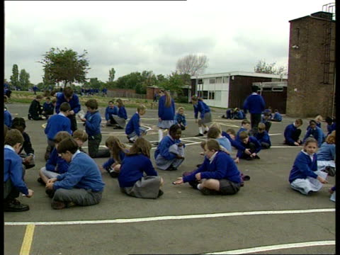 ; b)nao england: west midlands: sutton coldfield: banners road school: school corridor as child seen at side of screen rings handbell for break in... - school bell stock videos & royalty-free footage