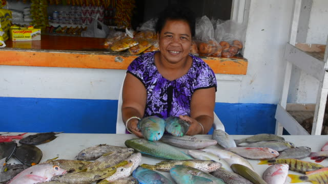 Pohnpei Micronesia woman selling fresh fish at market on stand