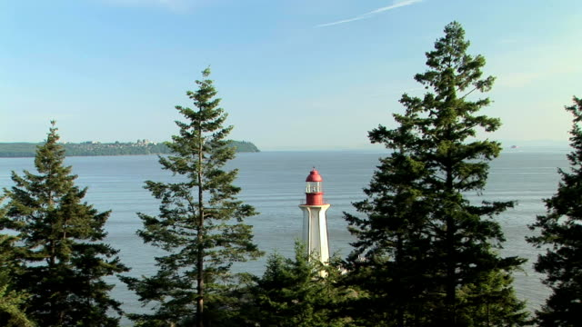 MS Point Atkinson Lighthouse at Lighthouse Park, trees in foreground, Vancouver, British Columbia, Canada