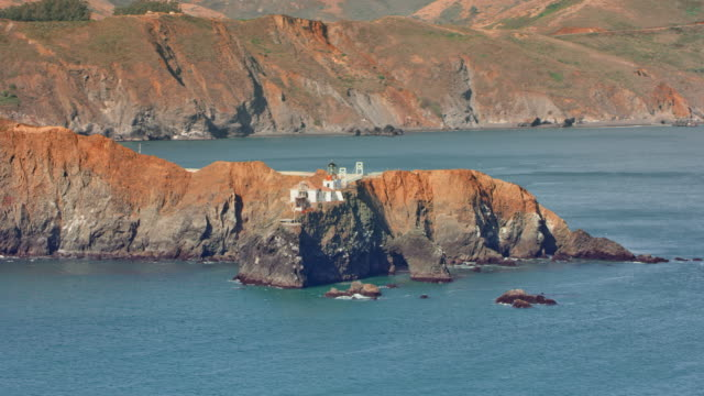 aerial point bonita lighthouse at the entrance into the san francisco bay - san francisco bay stock videos & royalty-free footage