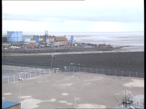 point of ayr colliery; wales point of ayr colliery seq gv colliery buildings and equipment and engineer sat on pipes - ayr stock videos & royalty-free footage