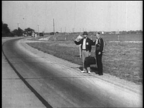 point of view 2 men with thumbs raised hitchhiking alongside country road - 1935 stock videos & royalty-free footage