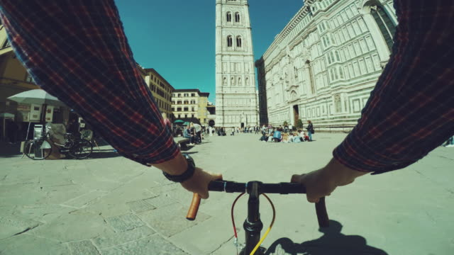 point of view pov bicycle: duomo of firenze - local landmark stock videos and b-roll footage