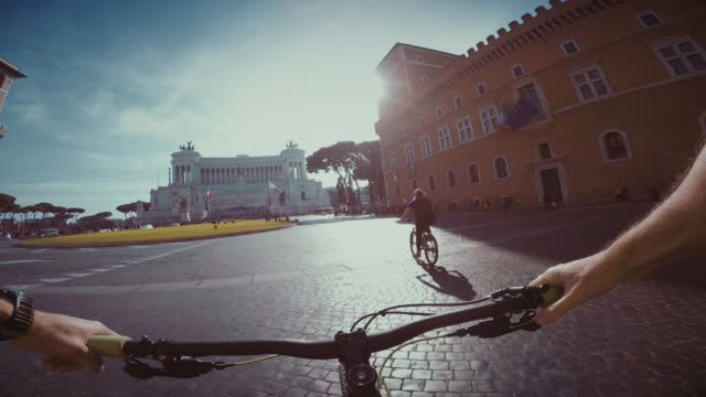point of view pov bicycle ride in rome - piazza venezia stock videos and b-roll footage