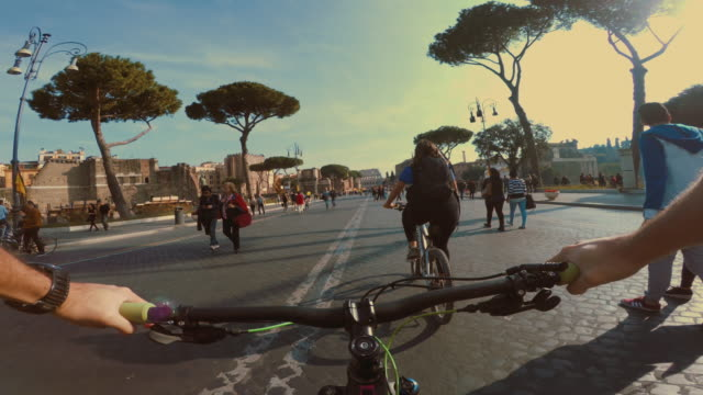 point of view pov bicycle ride to coliseum of rome - rome italy stock videos and b-roll footage