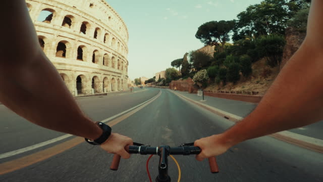 point of view pov bicycle to the coliseum of rome - car point of view stock videos & royalty-free footage
