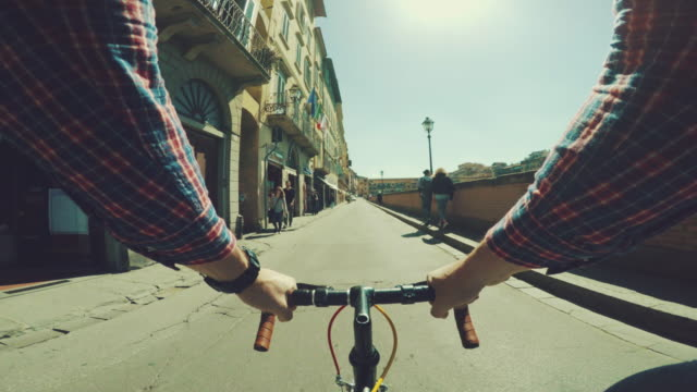 point of view pov bicycle: urban street of firenze - florence italy stock videos & royalty-free footage