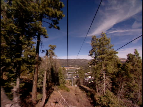 point of view b-roll footage from a ski lift. - ski lift point of view stock videos & royalty-free footage