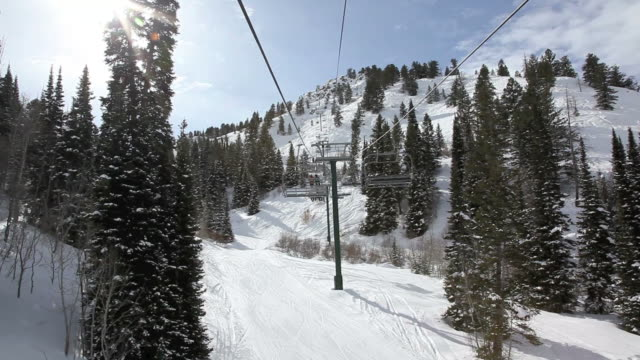 point of view chairlift going up at ski station - utah stock videos & royalty-free footage