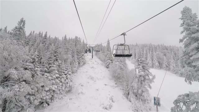point of view chairlift going up at ski station - ski lift stock videos & royalty-free footage