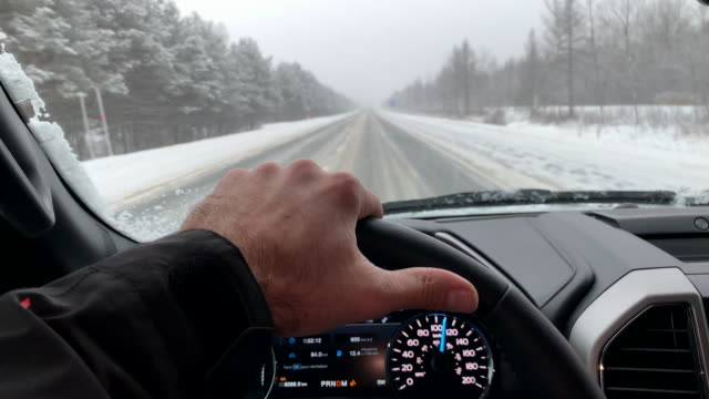point of view driving on highway in winter - windshield stock videos & royalty-free footage