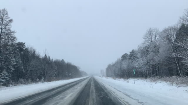 point of view driving on highway in winter - blizzard stock videos & royalty-free footage