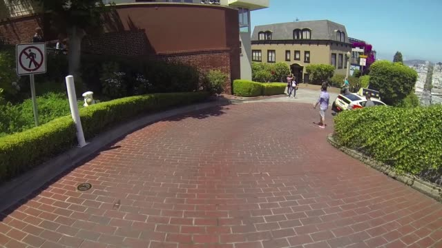 point of view driving shot of a car turning onto lombard street in san francisco california - lombard street san francisco stock videos & royalty-free footage