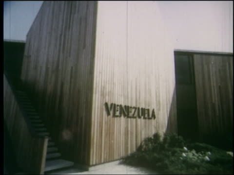1964 point of view exterior of venezuela pavilion at ny world's fair - esposizione universale di new york video stock e b–roll
