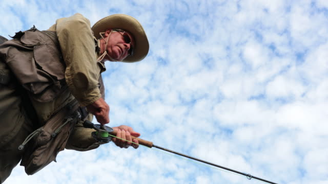 point of view fisherman fly fishing in river - fly fishing stock videos and b-roll footage