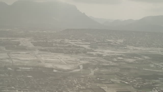 stockvideo's en b-roll-footage met point of view flying, taking off over kabul - afghanistan
