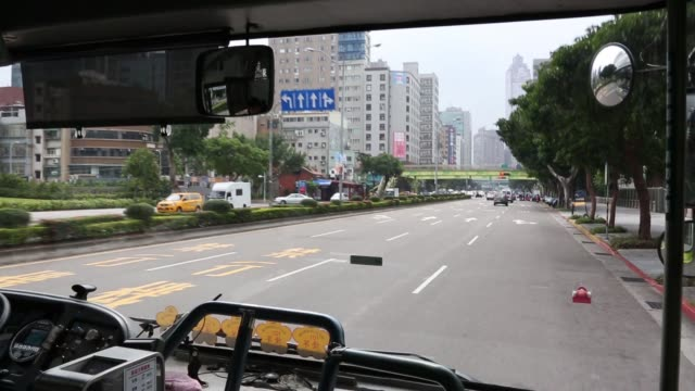 point of view from a bus driving on a road in taipei, taiwan, on monday, nov. 9 point of view a street and passing traffic from a passenger window of... - ナイトイン点の映像素材/bロール