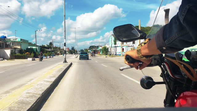 point of view from a 'motoneta' in the central road on july 21, 2017; in santa clara, villa clara, cuba. 'motonetas' or motorized tricycles are an... - tricycle stock videos & royalty-free footage
