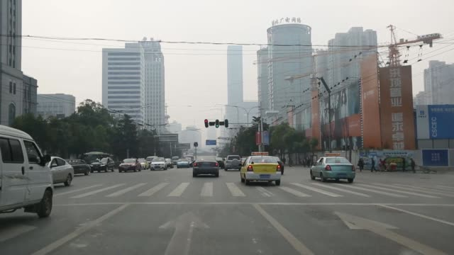 Point of view from a taxi window as it crosses a suspension bridge in Wuhan China on Sunday Oct 20 POV from moving car as it drives past high rise...