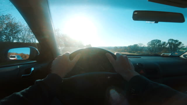 point of view from drivers perspective while driving car on highway - steering wheel stock videos & royalty-free footage