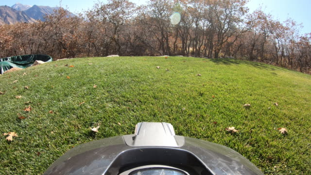 point of view from robotic lawn mower as to maneuvers through the yard - grass stock videos & royalty-free footage