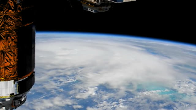 vídeos de stock, filmes e b-roll de point of view from the international space station. hurricane michael is expected to strike the florida panhandle and big bend as a category 4 which... - 2018