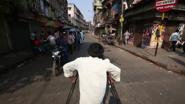 Point of view POV from the seat of a rickshaw as driver walks through the streets in Kolkata Kolkata street scenes on February 20 2013 in Kolkata...