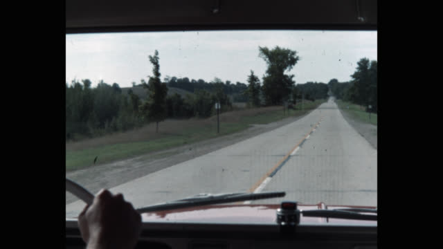 vidéos et rushes de point of view from windshield driving on country road, pulls off onto dirt road - intérieur de véhicule