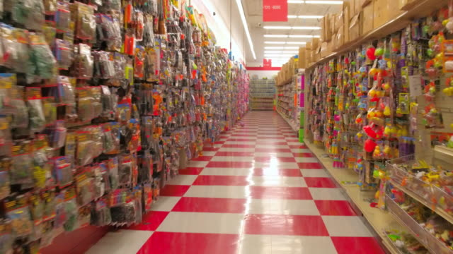 point of view image of a person walking in the corridors of a large store selling merchandise in toronto, canada. the products are displayed in... - sale stock videos & royalty-free footage