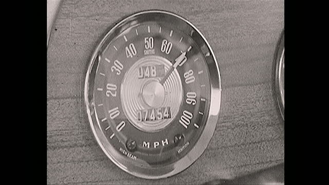 point of view inside car driving on british motorway, speedometer shows it driving at seventy miles per hour, 1967 - machine part stock videos & royalty-free footage