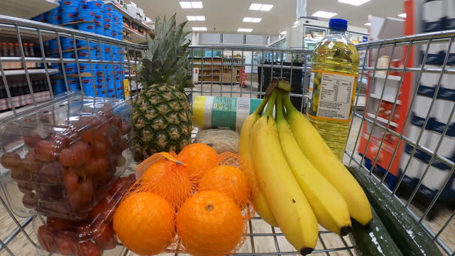 point of view inside shopping trolley. - pineapple stock videos & royalty-free footage