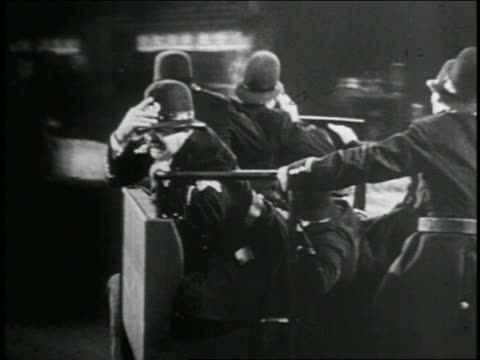 b/w 1935 rear view point of view keystone kops in police truck driving crazily through city streets / feature - 1935 stock videos & royalty-free footage