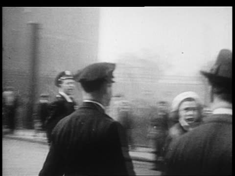 b/w 1932 point of view male police officers walking to grabbing female protestors / brooklyn ny - 1932 stock videos & royalty-free footage