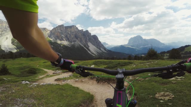 point of view pov mountain bike on dolomites - wearable camera stock videos & royalty-free footage